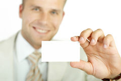 Businessman holding visit card isolated Stock Photo