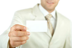 Businessman holding visit card isolated Royalty Free Stock Photography