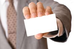 Businessman holding visiting card stock photo