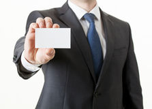 Businessman holding a visiting card Royalty Free Stock Photo