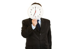 Businessman holding watch in front of face Royalty Free Stock Photos