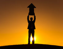 Businessman Holding The Way Forward Sign Royalty Free Stock Images