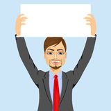 Businessman holding white blank board Royalty Free Stock Images