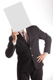 Businessman holding white blank paper over head Stock Photo