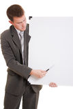 Businessman holding a white board. Businessman with a white board in his hands on a white background Stock Photo