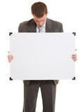Businessman holding a white board. Businessman with a white board in his hands on a white background Royalty Free Stock Photos