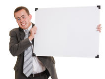 Businessman holding a white board. Businessman with a white board in his hands on a white background Royalty Free Stock Images