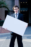 Businessman holding white board Stock Photography