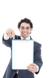 Businessman holding a white board, isolated on white background. Happy adult businessman with toothy smile holding a white board and showing with his hand on Stock Photography