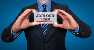 Businessman holding white card with Join our team sign, Blue stock image