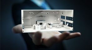 Businessman holding white 3D rendering apartment Royalty Free Stock Images