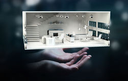 Businessman holding white 3D rendering apartment Royalty Free Stock Photo