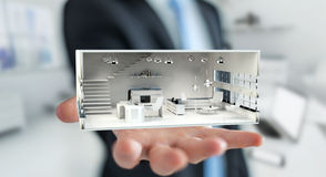 Businessman holding white 3D rendering apartment Stock Photography