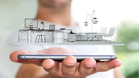 Businessman holding white 3D rendering apartment. Businessman on blurred background holding white 3D rendering apartment over mobile phone Royalty Free Stock Photography