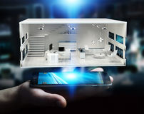 Businessman holding white 3D rendering apartment. Businessman on blurred background holding white 3D rendering apartment over mobile phone Stock Photos