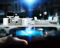 Businessman holding white 3D rendering apartment. Businessman on blurred background holding white 3D rendering apartment over mobile phone Stock Images