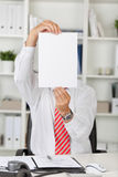 Businessman holding white paper Royalty Free Stock Image