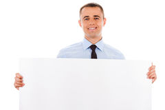 Businessman holding white placard Stock Image