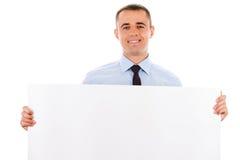 Businessman holding white placard Stock Image