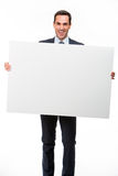 Businessman holding a white placard Stock Photos