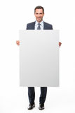Businessman holding a white placard Stock Images