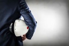 Businessman holding white safety helmet. Stock Photography