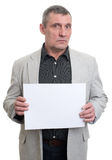 Businessman holding a white sheet in hands Royalty Free Stock Images