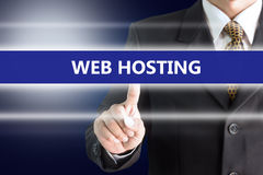A Businessman holding a white sign with the message WEB HOSTING. Royalty Free Stock Photography