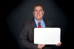 Businessman holding whiteboard Stock Image