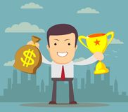 Businessman holding winner cup and money Stock Images
