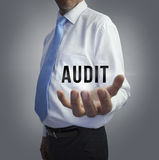Businessman holding the word audit Stock Photo