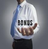 Businessman holding the word bonus Stock Image