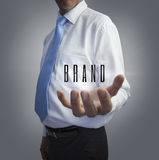Businessman holding the word brand Royalty Free Stock Photo