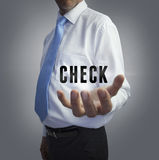 Businessman holding the word check Royalty Free Stock Photo