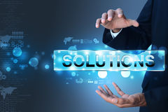 Businessman holding the word solution Stock Image