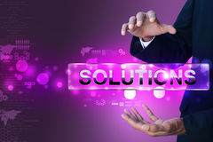 Businessman holding the word solution Stock Photography