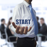 Businessman holding the word start Stock Images