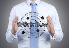 Businessman holding workflow Stock Photo