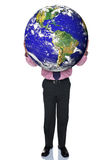 Businessman holding the world. Photo of a businessman holding the world in his hands, isolated on a white background Royalty Free Stock Photography