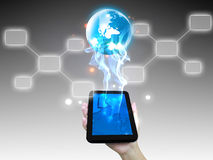 Businessman holding world. With touchscreen Stock Photos