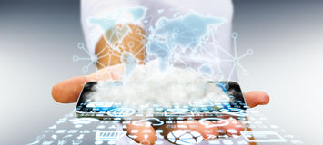 Businessman holding world and cloud. World over a cloud with connections and modern icons in businessman hand Stock Photo