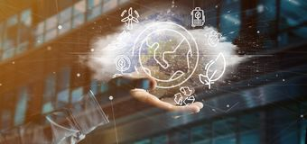 Businessman holding a World globe surronding by ecology icons an. View of a Businessman holding a World globe surronding by ecology icons and connection 3d stock image