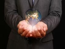 Businessman holding world in his hands. Business concept Royalty Free Stock Images