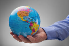 Businessman holding the world in his hands Royalty Free Stock Photography