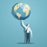 Businessman holding the world in his hands Stock Images