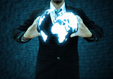 Businessman  holding a world technology Stock Photography