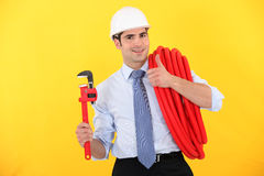 Businessman holding a wrench Stock Photo