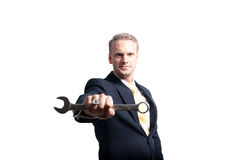 Businessman holding wrench closeup Stock Images