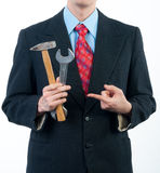 Businessman holding wrench and hammer. Isolated on white Royalty Free Stock Photos