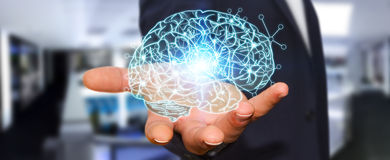 Businessman holding x-ray human brain in his hand Stock Photo